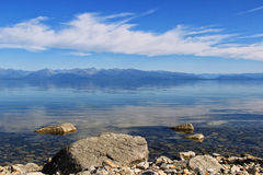 Crystal clear water of lake Baikal and  mountains Royalty Free Stock Photography
