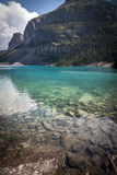 Crystal clear water of Moraine Lake near Banff Alberta Royalty Free Stock Images