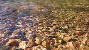 Crystal clear water in a mountain stones riverbed. Clear water in a mountain stones riverbed detail close up river rapids stock footage