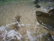 Beautiful wave breaks to the shore and it called swash. Crystal clear water on the shore beach stock photography