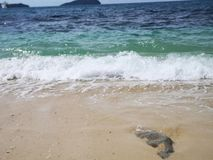 Beautiful wave breaks to the shore and it called swash. Crystal clear water on the shore beach stock images