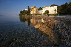 Crystal clear Water at Volosko Beach in Opatija, Croatia Royalty Free Stock Images