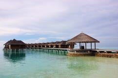 Crystal clear water and water villas, Maldives. Maafushivaru island with its water villas and jetty. Ari Atoll,Maldives Stock Images