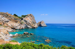 Crystal clear waters at Kastro beach, Skiathos, Greece royalty free stock photography