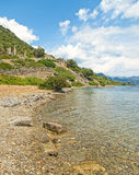 Crystal clear waters near island with medieval ruins Stock Photo