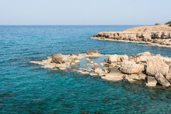 Crystal clear waters and sandstone rocks. Of the Mediterranean Sea, Cyprus Royalty Free Stock Photos