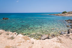 Crystal clear waters and sandstone rocks. Of the Mediterranean Sea, Cyprus Stock Photography