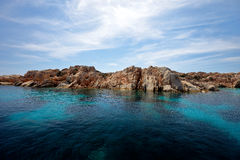 Crystal clear waters in a turquoise bay in Rhodes Royalty Free Stock Photography