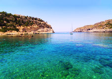 Crystal clear waters in a turquoise bay in Rhodes Royalty Free Stock Image