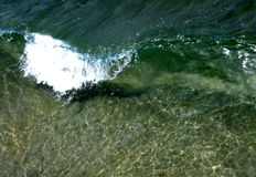 Crystal Clear Wave. Transparent breaking wave from high angle Stock Photography
