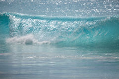 Crystal clear wave at the beach Stock Photos