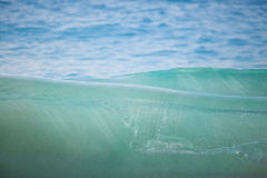Crystal clear wave at the beach stock image