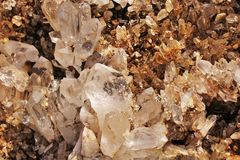 Crystal cluster. Beautiful quartz crystal cluster reflecting light Royalty Free Stock Photo