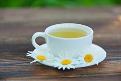Crystal cup with green tea on table Stock Image