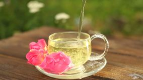 Crystal cup with green tea on the table. Crystal cup with green tea on table stock footage