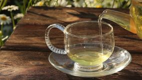 Crystal cup with green tea on table. Crystal cup with green tea on the table stock video