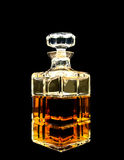 A crystal decanter with whiskey. In black Stock Images
