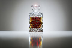 Crystal decanter with whiskey or brandy Royalty Free Stock Images
