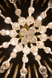 Crystal elegant chandelier with many lamps and jewelry stock photos