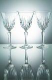 Crystal exponeringsglas med reflexion på vit upplyst bakgrund Arkivbild