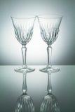 Crystal exponeringsglas med reflexion på vit upplyst bakgrund Royaltyfria Bilder