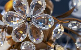 Crystal flower as an element of the crystal chandelier stock photography
