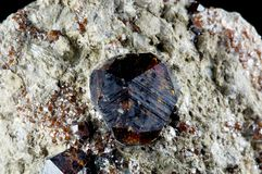 Crystal of garnet. In piece of ore Stock Images
