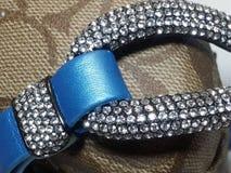 Crystal Gemstones on Blue Leather Bracelet. Closeup photo detailing the rhinestone embedded cuff of a bracelet. The band is blue leather with a satin finish Royalty Free Stock Photos