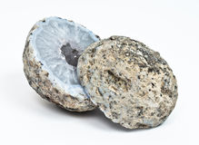Crystal geode divided in two parts. With white quartz crystals inside insolated Royalty Free Stock Image