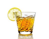 Crystal glass with alcohol and a slice of lemon Royalty Free Stock Photography