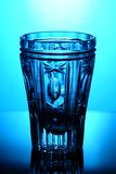 Crystal glass on a blue Royalty Free Stock Photos