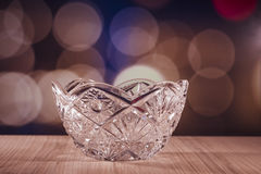 Crystal glass bowl with bokeh background Royalty Free Stock Photo