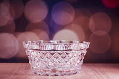 Crystal glass bowl with bokeh background Royalty Free Stock Images
