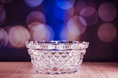 Crystal glass bowl with bokeh background Royalty Free Stock Photography