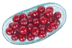 Crystal glass bowl with cherries. Crystal glass bowl ful of fresh cherries isolated on white Stock Photo
