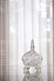 Crystal glass container. On the table with white curtain background Stock Image