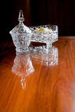 Crystal glass container. On wooden table Stock Image
