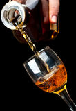 Crystal glass filled with brandy Stock Photography