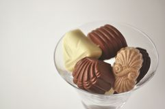 Crystal glass full of chocolates Royalty Free Stock Images