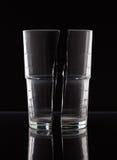 Crystal Glass halved on black Royalty Free Stock Image