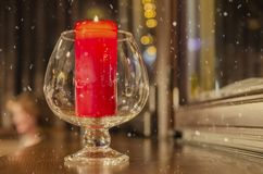 Crystal glass with a lit candle inside stock images