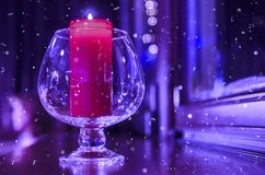 Crystal glass with a lit candle inside royalty free stock image