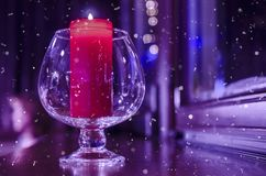 Crystal glass with a lit candle inside royalty free stock images