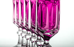 Crystal glass with pink fluid. Six elegant crystal glass with pink liquid online Royalty Free Stock Photos