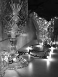 A crystal glass sits in front of holiday and Christmas decorations Royalty Free Stock Photo