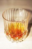 Crystal glass with whiskey dose Stock Photos