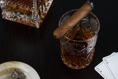 Crystal glass of whisky and a cigar Royalty Free Stock Photo