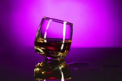 Crystal glass with whisky isolated over pink background stock photos