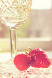 Crystal Glass with Wine and Strawberry Stock Photo