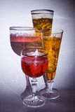 Crystal glasses. Two crystal wine-glasses with drinks Stock Photo